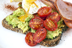 Avocado Toast with Cherry Tomatoes Poached Egg and Bacon Top Vie Stock Image