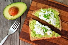 Avocado toast with egg whites and pea shoots, overhead view Stock Photography