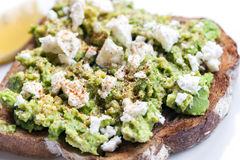 Avocado Toast with Feta Cheese Lemon and Spices royalty free stock photography