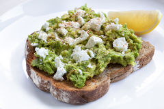 Avocado Toast with Feta Cheese Lemon and Spices Royalty Free Stock Photo
