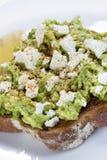 Avocado Toast with Feta Cheese Lemon and Spices. Avocado on toast with feta cheese, lemon and spices Royalty Free Stock Photography