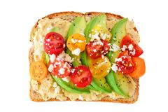 Avocado toast with hummus and tomatoes isolated on white Stock Photo