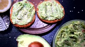 Avocado toast , overhead viewy avocado sandwich on toast bread made with fresh avocado paste. On the black background stock footage