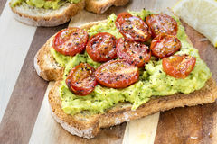Avocado Toast with Roasted Cherry Tomatoes Stock Photography