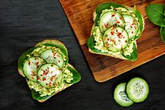 Avocado toast sandwiches with cucumber and spinach Royalty Free Stock Photo