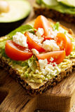 Avocado toast with tomatoes and feta Stock Images