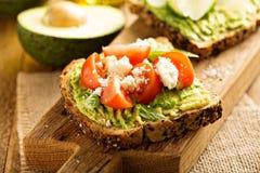 Avocado toast with tomatoes and feta Royalty Free Stock Photo