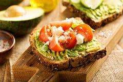 Avocado toast with tomatoes and feta Stock Photo