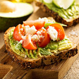 Avocado toast with tomatoes and feta Royalty Free Stock Images
