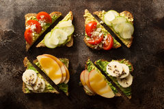 Avocado toast with various toppings Stock Photography