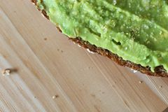 Avocado toast on wooden board, overhead view. royalty free stock image