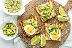 Avocado toasts, healthy snack stock images