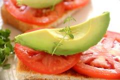 Avocado On Tomato Stock Photo