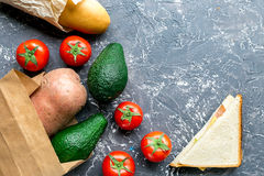 Avocado and tomato with bread on table background top view mock up Stock Images