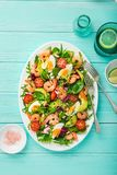 Avocado, tomato, eggs and shrimps salad Stock Photos