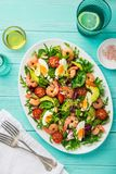 Avocado, tomato, eggs and shrimps salad Stock Photo