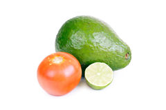 Avocado, tomato and lime isolated on white Royalty Free Stock Image