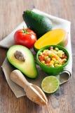 Avocado, tomato, mango salad Stock Photo