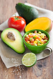 Avocado tomato mango salad Stock Photos