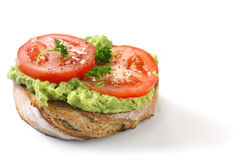 Avocado and Tomato on Rye Toast Royalty Free Stock Photography