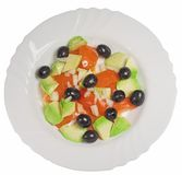 Avocado and tomato salad. With onion and olives stock images