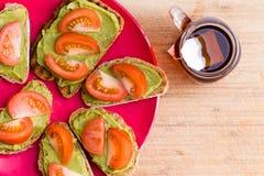 Avocado and tomato sandwiches with tea Royalty Free Stock Photos