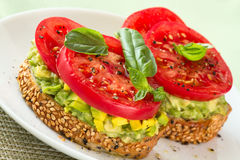 Avocado and Tomato on Toast. Royalty Free Stock Photo