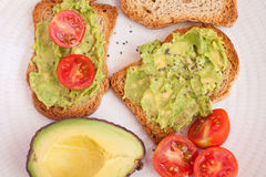 Avocado, tomato on toast Stock Photo