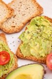 Avocado, tomato on toast Royalty Free Stock Image