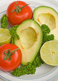 Avocado, tomatoes and limes. Royalty Free Stock Image