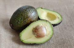 Avocado. Two avocados on the tablecloth, avocado cut Royalty Free Stock Photography