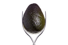 Avocado between two forks. Isolated on white Stock Images