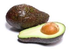 Avocado und eine Hälfte stockbild