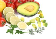 Avocado with vegetables and citrus. Royalty Free Stock Image