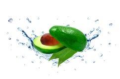 Avocado water splash. Avocado splash water isolated on white royalty free stock image