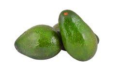 Avocado on white. Some avocado fruit, isolated on a white background Stock Photos