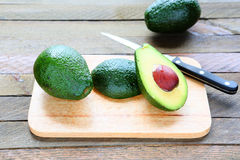 Avocado whole and sliced royalty free stock images
