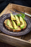 Avocado and whole wheat toast Stock Photos