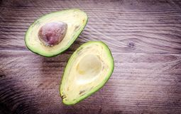 Avocado on the wooden background Stock Photos