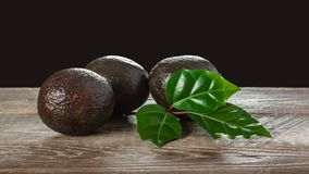Avocado on a wooden background Royalty Free Stock Photography
