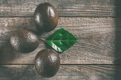 Avocado on a wooden background Royalty Free Stock Photo