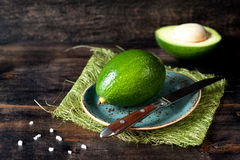 Avocado on a wooden board Royalty Free Stock Photos