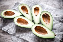 Avocado on the wooden table Royalty Free Stock Image