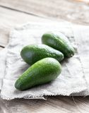 Avocado on the wooden table Royalty Free Stock Photography