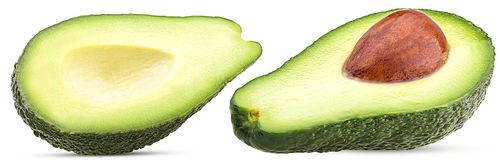 Avocado zwei geschnitten zur Hälfte mit den Gruben, Löcher gebildet stockfotos