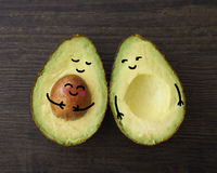 Avocadoeltern mit ihrem Kind oder Baby Lizenzfreies Stockfoto
