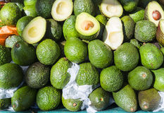 Avocadoes, whole and halved, in French market. stock images