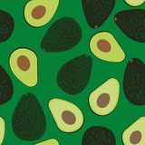 Seamless vector pattern with cut and whole avocados vector illustration