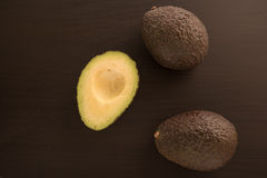 Avocados on a black background. Stock Photography