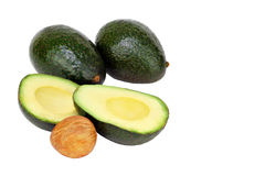 Avocados cut and whole isolated Royalty Free Stock Photo